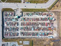 Aerial view of a large number of iron garages for cars with colored roofs standing in close to each other near the road fenced. Parking of vehicles for the royalty free stock photo