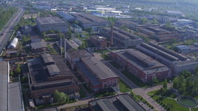 Aerial View Large Production Plant Territory against City stock video footage