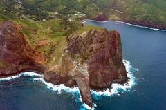 Aerial view of a large rock on the coast of Maui in Hawaii. Dramatic rock formation and two bays on the east coast north of the town of Kahului, Maui, in Hawaii Royalty Free Stock Images