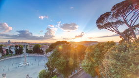 Aerial view of the large urban square, the Piazza del Popolo timelapse, Rome at sunset. With the fiery orb of the sun dropping below the horizon above the stock video footage
