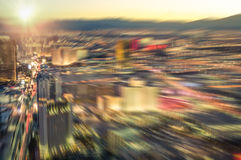 Aerial view of Las Vegas skyline at sunset - Blurred city lights. From downtown strip boulevard - Vintage filtered look with radial zoom defocusing stock image