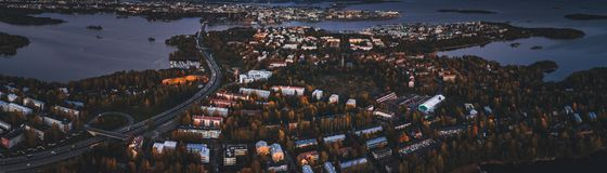 Aerial view of Lauttasaari part of Helsinki Finland with darkness falling over the island. And lots of traffic on the highway royalty free stock photo