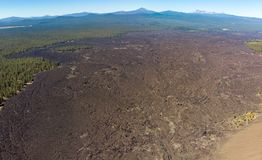 Aerial view of lava fields surrounding Lava Butte cinder cone stock photos