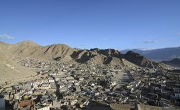 Aerial view of the Leh town. Aerial view of the arid Leh town from the Leh Palace perched over a hill top shows clusters of houses and craggy mountains royalty free stock photography
