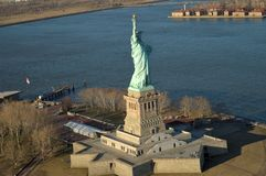 Aerial view of Liberty Island. With Statue of Liberty at sunset time royalty free stock images