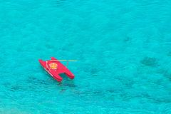 Aerial view of lifeguard boat salvataggio in beautiful clear tropical sea water from Tropea Italy. Baywatch rescue italian boat with oars and life preserver in royalty free stock photo