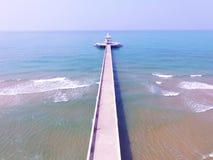 Aerial  view of light house pier and blue sea beach Stock Photos