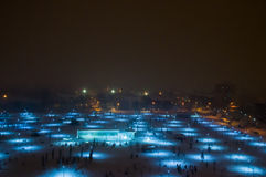 Aerial view of a lightened park in snow Stock Photos