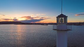 Aerial view of lighthouse at sunset in Varna seaport, Bulgaria.  stock footage