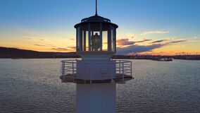 Aerial view of lighthouse at sunset in Varna seaport, Bulgaria. Aerial drone view of lighthouse at sunset in Varna seaport, Bulgaria stock video