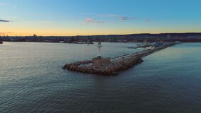 Aerial view of lighthouse at sunset in Varna seaport, Bulgaria.  stock video footage