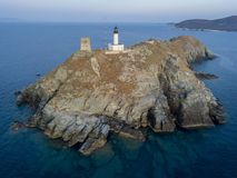 Aerial view of the Lighthouse and Tower on the island of Giraglia. Cap Corse peninsula. Corsica. France stock photos