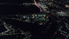 Aerial View of Lights and Traffic in Oakland, California at Night. An aerial view of the highways in Oakland, CA. The city is known for its sustainability stock footage
