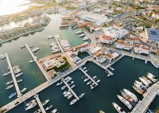 Aerial view of Limassol Marina, Cyprus. Aerial view of the beautiful Marina in Limassol city in Cyprus, the beach, boats, piers, villas and commercial area. A Royalty Free Stock Photography