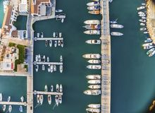 Aerial view of Limassol Marina, Cyprus. Aerial view of the beautiful Marina in Limassol city in Cyprus, the boats lined up, piers, and commercial area from above Royalty Free Stock Photo
