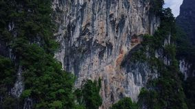 Aerial view of limestone rocks covered with lush tropical greenery. Top view of mountains in Krabi and Suratthani. Provinces, Thailand shot with a DJI Mavic stock video footage