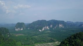 Aerial view of limestone rocks covered with lush tropical greenery. Top View of Mountains in Krabi and Suratthani. Provinces, Thailand shot with a DJI Mavic stock video