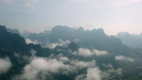 Aerial View of Limestone Rocks in Mist Covered with Lush Tropical Greenery. Top View of Mountains in Krabi and. Suratthani Provinces, Thailand shot with a DJI stock video