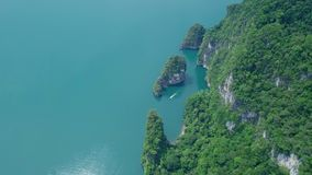 Aerial view of limestone rocks rising from water. Top view of mountains in Khao Sok National Park on Cheow Lan Lake. Thailand shot with a DJI Mavic fps29,97 4k stock footage