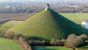 Aerial view of The Lion`s Mound with farm land around. stock video footage