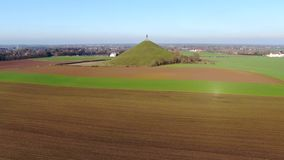 Aerial view of The Lion`s Mound with farm land around. stock video