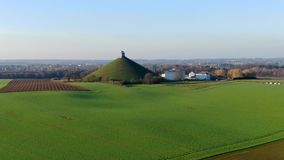 Aerial view of The Lion`s Mound with farm land around. stock footage