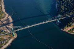 Aerial view of Lions Gate Bridge in Stanley Park. During a vibrant sunny summer day. Located in Vancouver, BC, Canada royalty free stock photo
