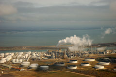 Aerial view of liquid storage tanks and the coast Royalty Free Stock Photography