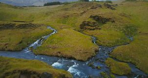 Aerial view of little river, stream became a powerful waterfall Gljufrabui in Iceland. Copter flying over turbulent flow. Aerial view of the little river, stream stock video