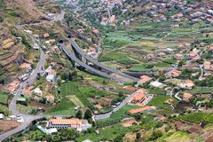 Aerial view of little villages and a highway in the mountains of Madeira Island Royalty Free Stock Image