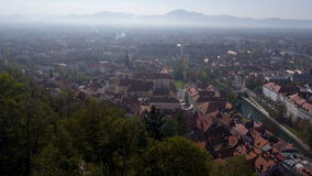 AERIAL: View of a Ljubljana cityscape with morning mist above it stock video