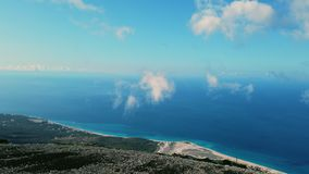 View from Llogara pass in Llogara National Park in Albania. Aerial view from Llogara pass to Albanian Riviera beach, clouds and Ionian Sea coastline stock video footage