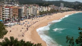 Aerial view of `LLoret de Mar`.Tilt-shift effect.Time lapse. Village of the province of Girona Catalonia, a springtime sunny day with the fast movement of waves stock video