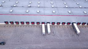 Aerial view on loading bays in distribution center. Aerial stock photography