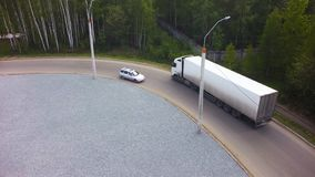 Aerial View of Loading Warehouse with Semi Truck. Clip. Aerial Top View of Trucks with Cargo Semi Trailer Moving on the royalty free stock photo