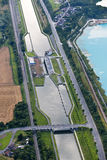 Aerial View : Lock in a channel. With a bridge Stock Photo