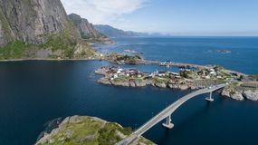 Aerial view on the lofoten. Beautiful summer landscape in the Norway. Traditional red houses. stock photography