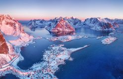 Aerial view at the Lofoten islands, Norway. Mountains and sea during sunset. Natural landscape from air at the drone. Norway at the winter time stock photos
