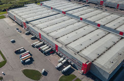 Aerial view of logistic center. Aerial view of trucks loading at logistic center Royalty Free Stock Photos
