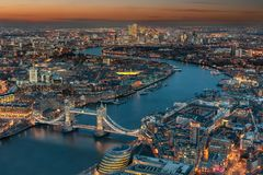 Aerial view of London during evening time. Aerial view of London: from the Tower Bridge along the rover Thames to the financial district Canary Wharf during stock images