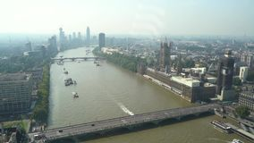 Aerial view of London with Westminster Bridge, Big Ben and the Houses of parliament in the dis stock footage