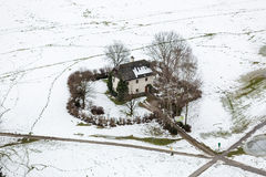 Aerial view on lonely house in field covered by snow at Salzburg Royalty Free Stock Photography