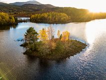 Aerial view of lonely Island in Loch Garry in the scottish Highlands, Scotland royalty free stock image