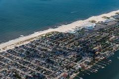 Aerial view of Long Beach in New York through airplane window. Against ocean stock photos