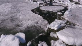 Aerial view on looking down on volga river with beautiful frozen ice. Aerial top down view over icy river surface pattern. Winter season on Volga river.Aerial stock video