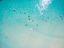 An aerial view of surfers at the beach Stock Image