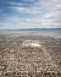 Aerial view of Los Angeles. A sweeping aerial shot of Los Angeles showing symmetrical rows of buildings and roads leading into downtown, with mountains and smog stock image