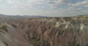 Aerial View of Goreme, Turkey. Aerial view of love valley in Goreme village, Turkey. countryside lifestyle. Top view of beautiful rural volcanic mountain stock video