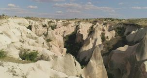Aerial View of Goreme, Turkey. Aerial view of love valley in Goreme village, Turkey. countryside lifestyle. Top view of beautiful rural volcanic mountain stock footage