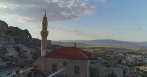 Aerial View of Goreme, Turkey. Aerial view of love valley in Goreme village, Turkey. countryside lifestyle. Top view of beautiful rural volcanic mountain stock video footage